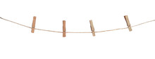 Four Wooden Clothespins On A Rope, Isolated On White Background