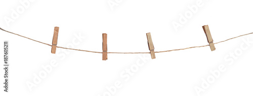 Four wooden clothespins on a rope, isolated on white background Canvas Print