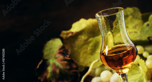 Golden Alcoholic Drink Being Poured Into Shot Glass, Rustic Still Life, Selective Focus
