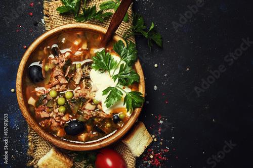 Deurstickers Klaar gerecht Russian Meat Solyanka Soup In Wooden Bowl, Top View