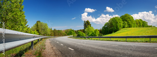 asphalt road panorama in countryside on sunny spring day