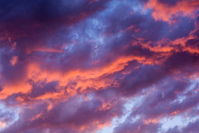Dramatic Fiery Sunset Sky In A Mixture Of Violet, Pink, Orange And Black Colors