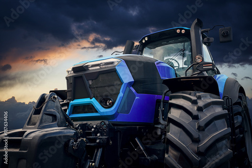 Powerful tractor against a stormy sky