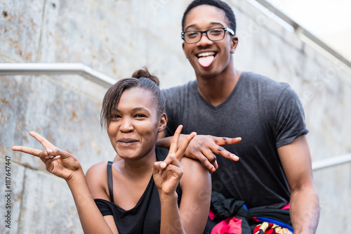 portrait of young african american couple making funny faces while