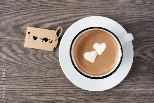 Foto op Plexiglas Chocolade Cup of hot chocolate with heart shaped marshmallows and I love you tag over a wooden background