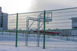 Basketball court in the winter under the snow