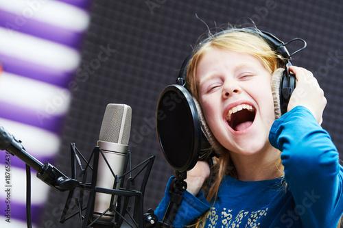 Obraz na plátně Regording studio. Child girl singing or role voicing