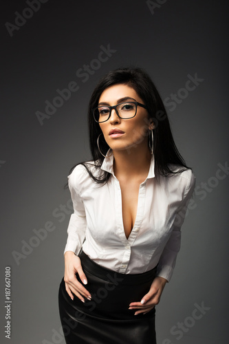 f6c829d348 Sexy brunette in a white blouse with a black leather skirt. - Buy ...