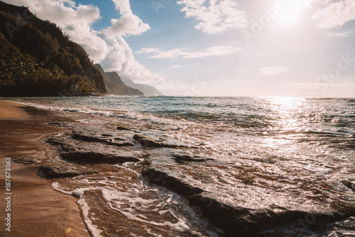 Fotografie, Obraz  Beautiful sunset at the beach on the island of Kauai near Na Pali cliffs