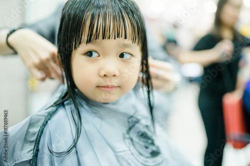 Asian little girl haircut. hairdresser, beauty salon