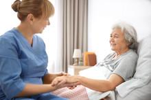 Caregiver Massaging Hand Of Se...