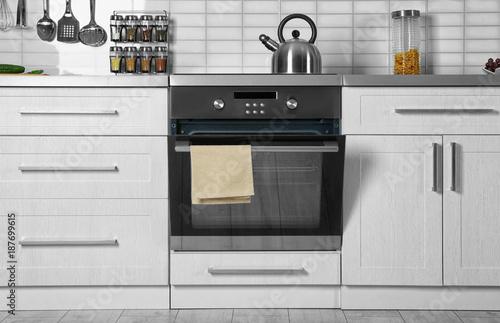 Fotografie, Tablou Modern kitchen interior with new oven