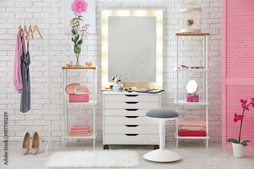 View of makeup room with decorative cosmetics and tools on dressing table Canvas Print