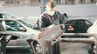 Man worker in automobile service - manual labor - polishes car