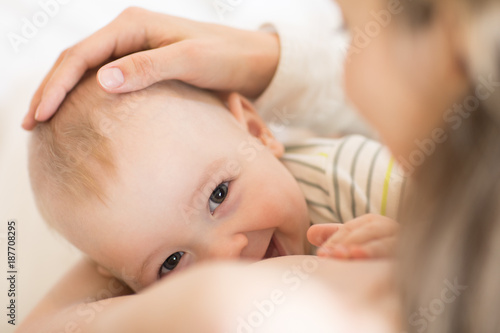 Obraz Picture of baby feeds mom's breast - fototapety do salonu