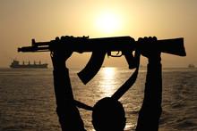Silhouette Of Machine Gun In M...