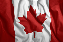 The Canadian Flag Flies In The Wind. Colorful National Flag Of Canada. Patriotism, Patriotic Symbol.