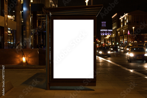 Obraz Blank white mock up of vertical light box in a bus stop at night - fototapety do salonu