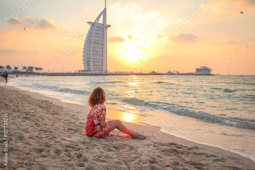 Recess Fitting Dubai Woman Sitting On The Beach At Sunset 2