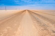 Endless Straight Sand And Gravel Roads Crossing The Namib Desert, Namibia