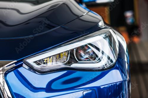 Obraz Macro view of modern car headlight - fototapety do salonu