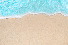 Background Image Of Soft Wave Of Blue Ocean On Sandy Beach.  Ocean Wave Close Up With Copy Space For Text.