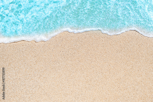 Poster de jardin Eau Background image of Soft wave of blue ocean on sandy beach. Ocean wave close up with copy space for text.