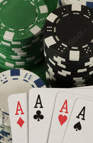poker game with chips on green background плакат