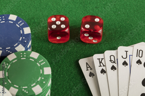 фотография  poker game with chips on green background