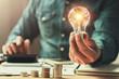 Leinwandbild Motiv business finance and saving power. new idea solar energy with accounting concept