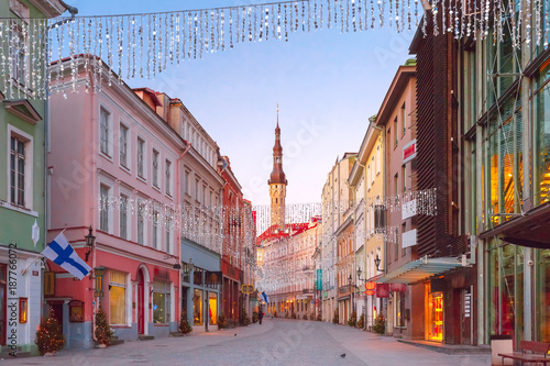 Canvas Prints Eastern Europe Beautiful illuminated street of Medieval Old Town and Town Hall in the morning blue hour, Tallinn, Estonia