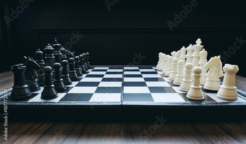 Fotografía Beginning of the game, Two chess teams in front of different color white and bla