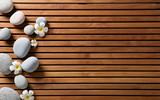 zen pebbles and spa flowers set on hammam wooden board