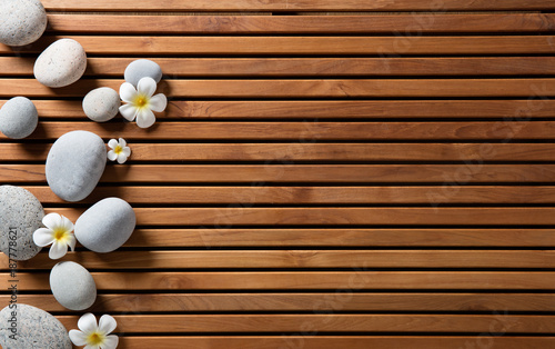 Fotobehang Spa zen pebbles and spa flowers set on hammam wooden board