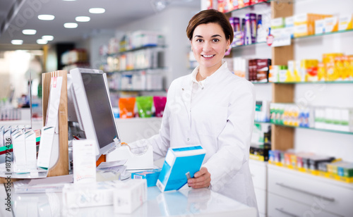 Fotobehang Apotheek Pharmacist ready to assist in choosing at counter