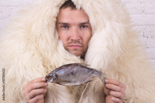 a man with a fish in a white skin Canvas Print