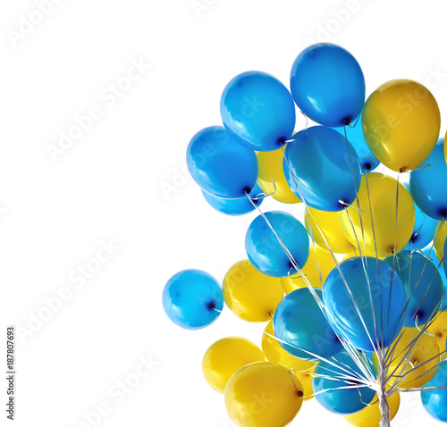 Valokuva bunch  of blue and yellow  balloons in the city festival isolated on white backg