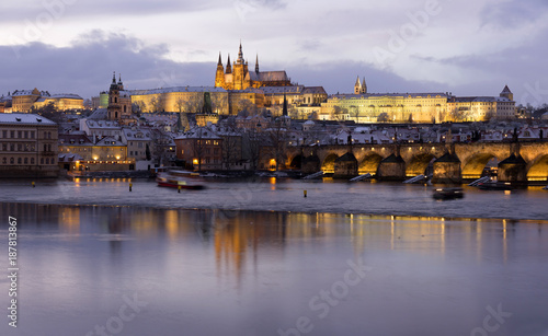 Poster Praag Evening colorful snowy Christmas Prague Lesser Town with gothic Castle and Charles Bridge, Czech republic