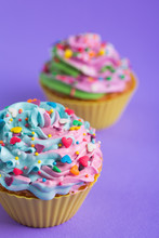Two Cupcakes With Creamy Multi...