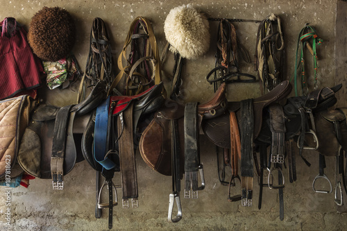 Foto op Aluminium Wand Saddles hanging on wall