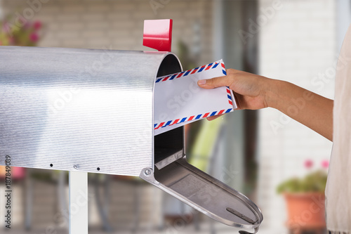 Leinwand Poster Person Removing Letter From Mailbox