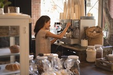 Smiling Waitress Making Cup Of Coffee