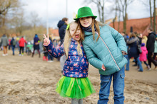Two Cute Girls Wearing Green H...