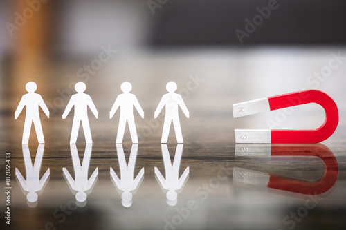 Magnet Attracting Paper Cut Out Standing In Row Wallpaper Mural