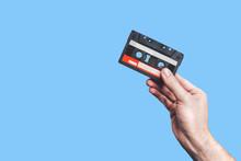 Hand Holding  Cassette Tape. U...