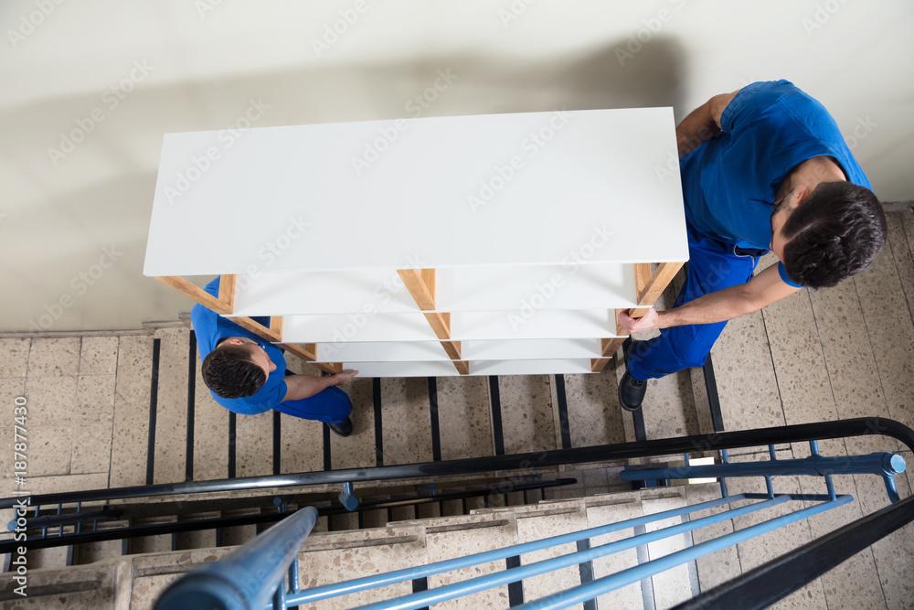 Fototapety, obrazy: Two Men Carrying Shelf