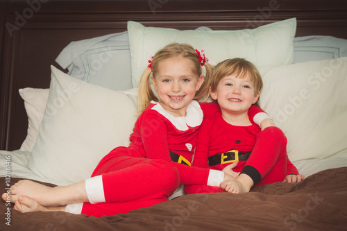 Sleepyheads Christmas Family Matching Red Striped Elf Pajama Pj Sets.  adorable brother and sister siblings cuddling together on bed in christmas  pajamas 88cbdf72f