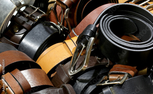 Valokuvatapetti many leather belts for sale