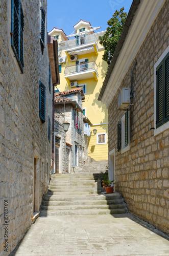 Fotobehang Mediterraans Europa Narrow street in Old Town of Herceg Novi (