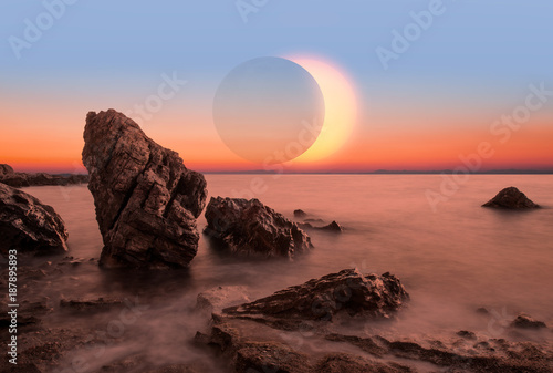 Long Exposure of colorful sunset with solar eclipse